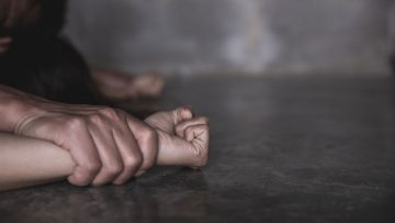 Man's Hand Holding A Woman Hand For Rape And Sexual Abuse Concep